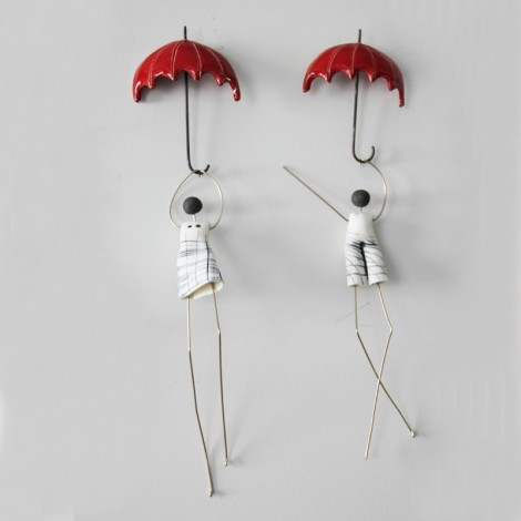 Figures with umbrella...
